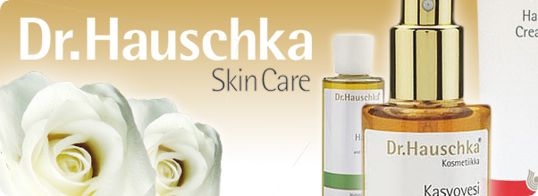 Logotyp för varumärket Dr. Hauschka, guld text, vit bakgrund